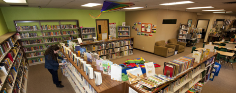Library shelves and reading area