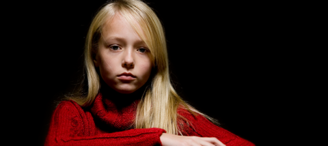 Sad girl wearing a red sweater