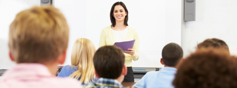 Teacher in front of class during vocabulary instruction