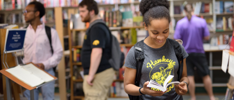 Teen browsing books at book store