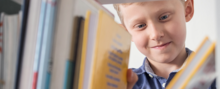 Boy selecting book from shelf