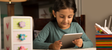 Girl using assistive technology at home