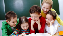 Small group of students reading a book