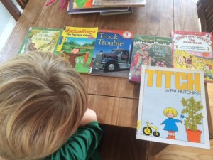 Child with 6 books spread on table