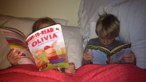 Kids reading in bed